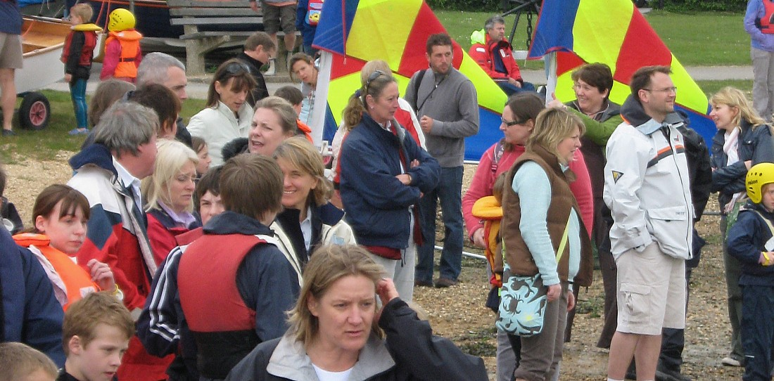 Parents view the action afloat from Hamble foreshore